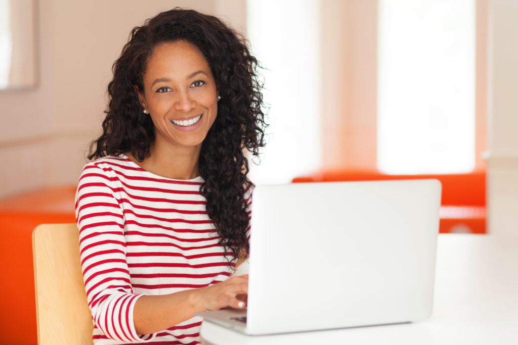 African-American-Woman-Working-on-a-laptop