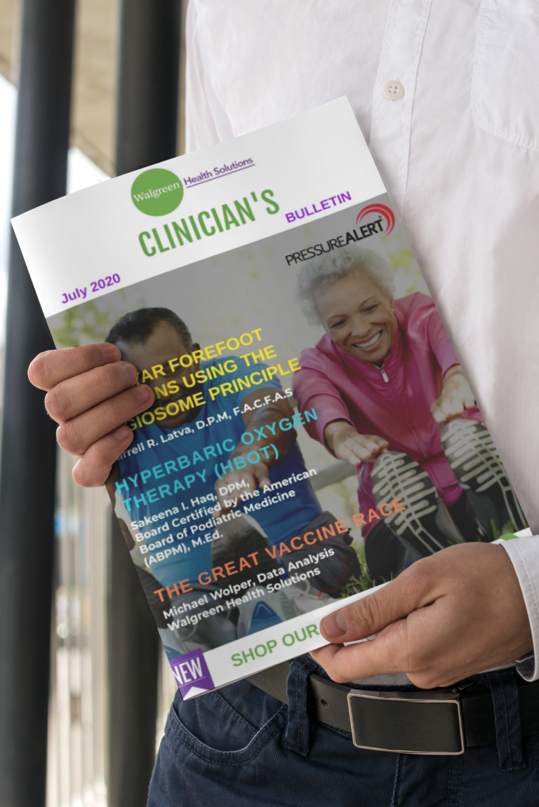 mockup-of-a-formal-man-holding-a-clinician-bulletin-magazine
